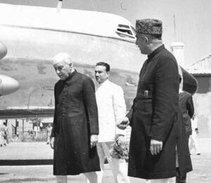 Bakshi Gulam Mohd, Prime Minister of J_K, receving Mr Nehru, Prime Minister of India