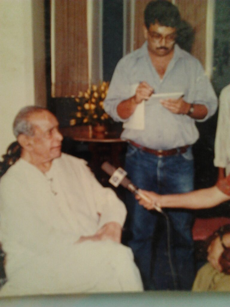 The author taking notes as the maestro speaks in Mumbai, for the launch of the six-cassette series to mark his 75th birthday in 1997