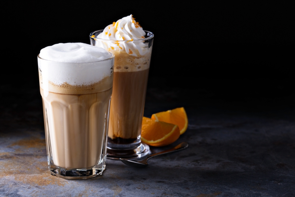 Coffee latte and viennese coffee with whipped cream and orange zest
